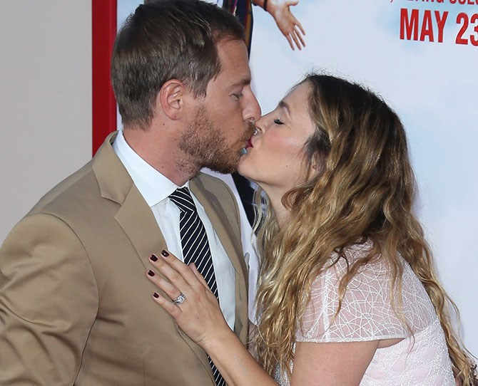 Drew Barrymore and Will Kopelman are ALL about those red carpet kisses. Seriously, we had trouble narrowing it down to one photo.