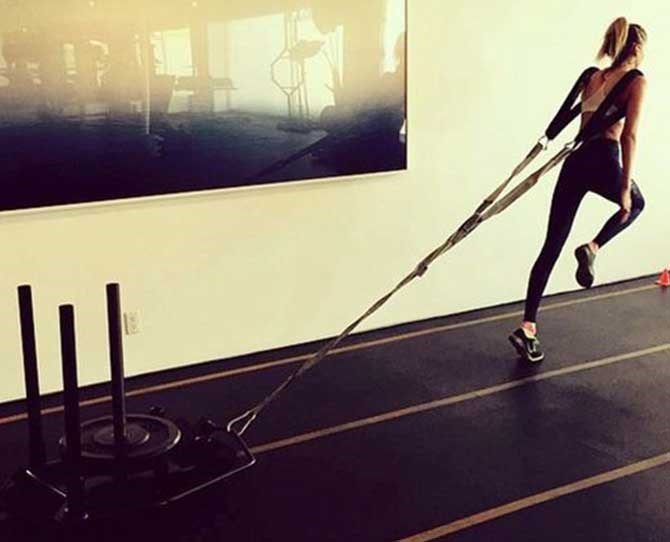 Stella Maxwell knows a thing or two about resistance training. Walking the catwalk will be a breeze compared to this!