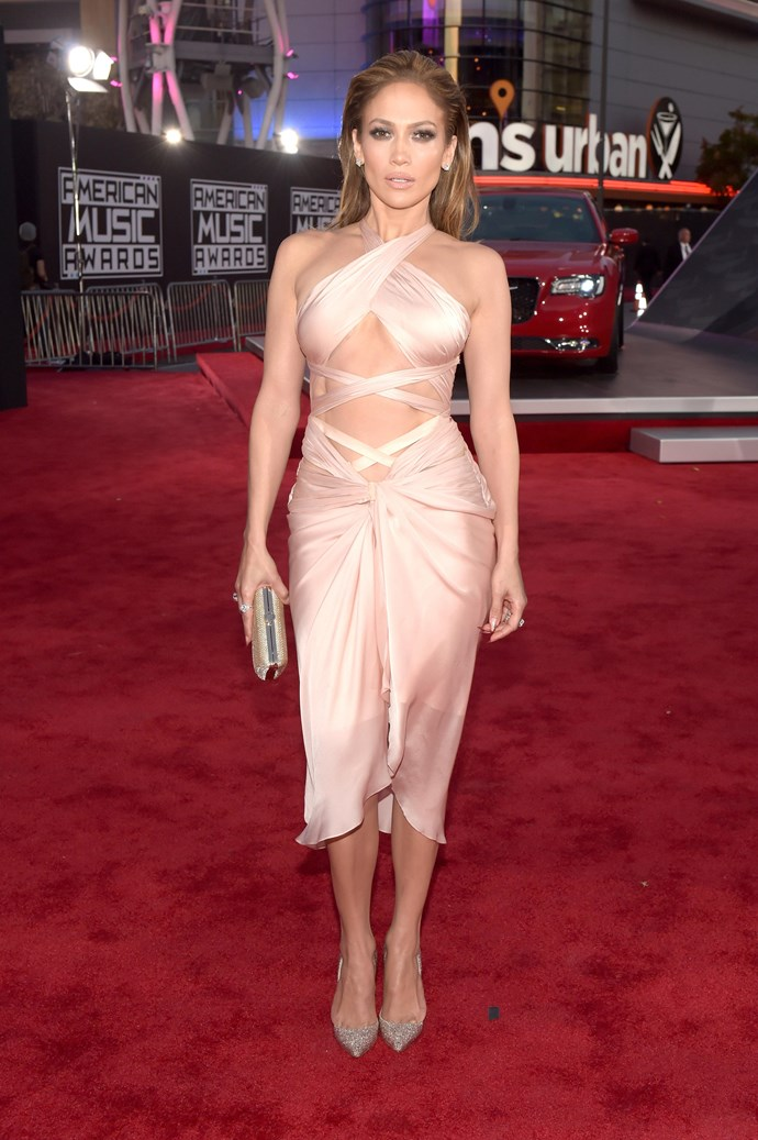 JLo's staple look ATM is a nude hue and cut outs. Case in point: Her American Music Awards look. Bonus points for the slicked back 'do.