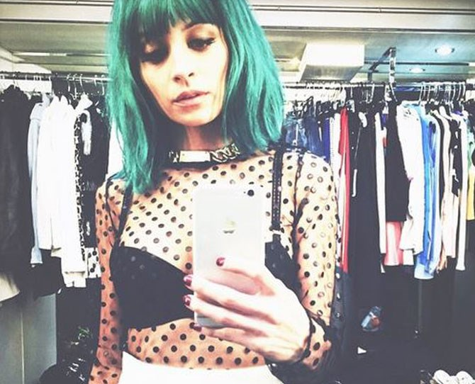 Nicole Richie takes a page out of Kylie Jenner's book with her blue hair and bangs.