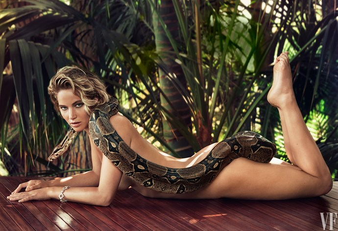 But enough with the fishes! Jennifer Lawrence is more of a boa gal. So she let one slither over her ass for *Vanity Fair*.