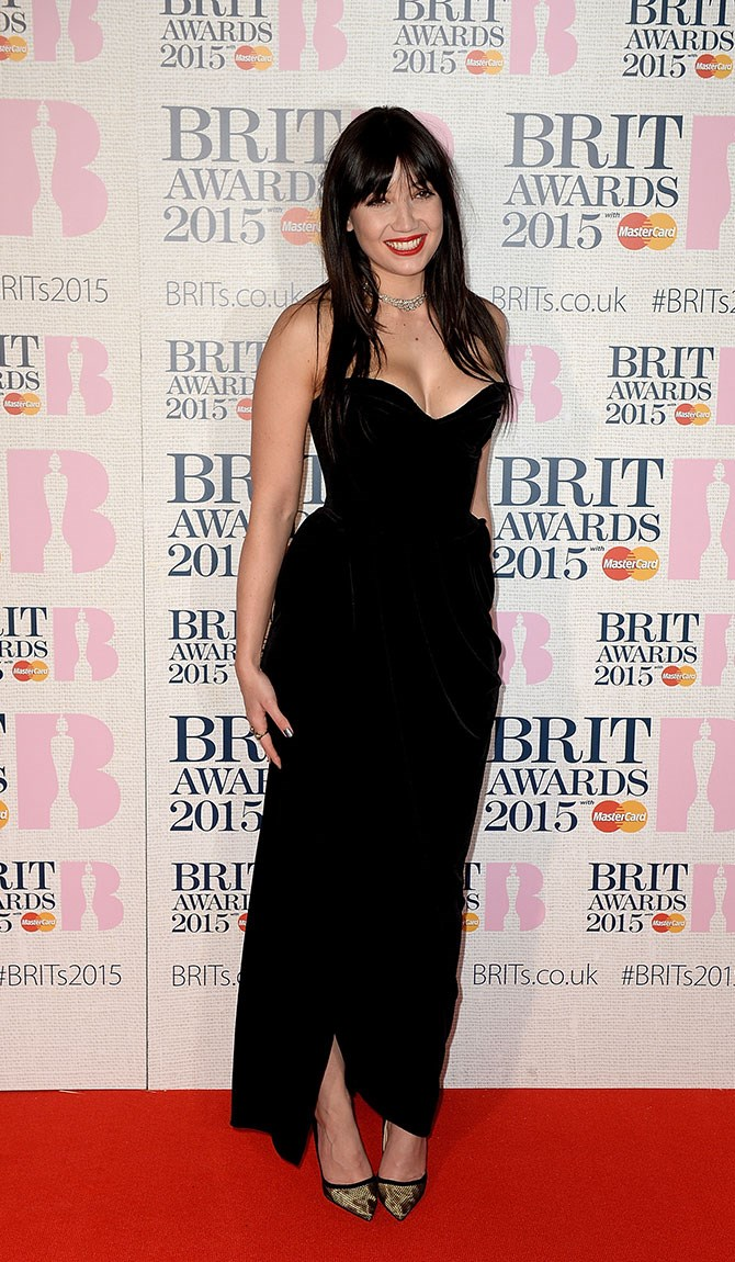 Daisy Lowe opted for a simple black gown with a smokin' hot neckline. PHWOAR.