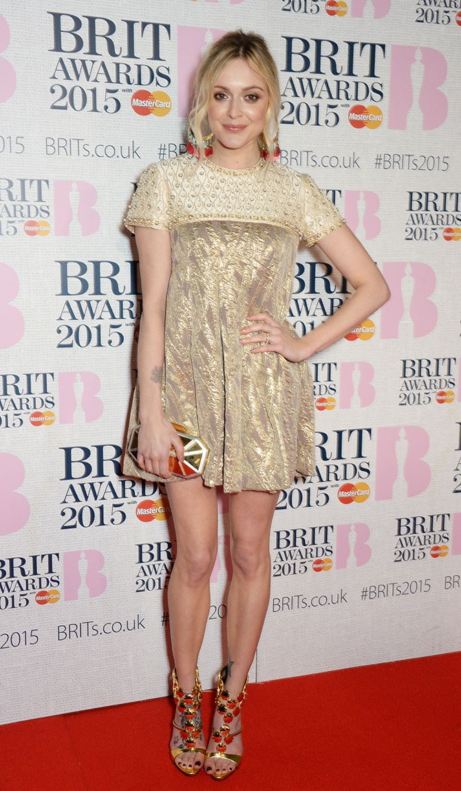 Fearne Cotton is head to toe magic in an ornate party shift, gold coin heels and tassled earrings.