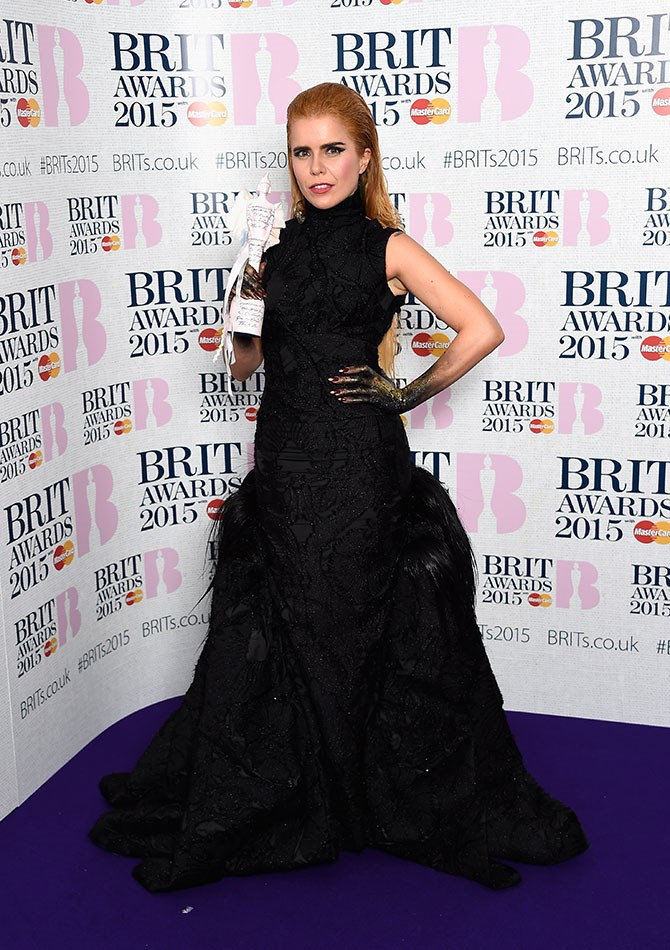 Are Paloma Faith's hands dipped in glitter and tar? Was there a Halloween dress code we missed?