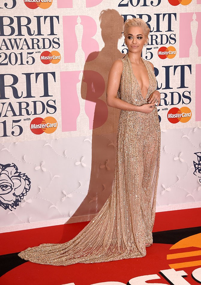 We're ll about this STUNNING sequinned jumpsuit. And also, Rita Ora in general.