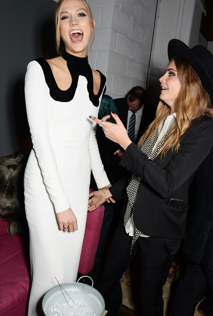 Cara just cannot believe how tall Karlie Kloss is. Neither can we, Cara. Neither can we.