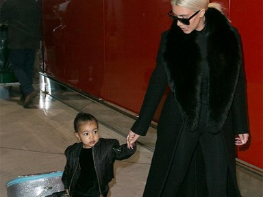 These pictures of North West dragging her Frozen suitcase are just too much