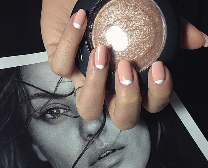 New York Fashion Week favourite, the half-moon nail, is making a statement in a HUGE way. Whether it's a chic nude-white combo like this or a contrast of matte-glossy in the one nail, we're so ready to fuss over this understated yet eye-catching trend.