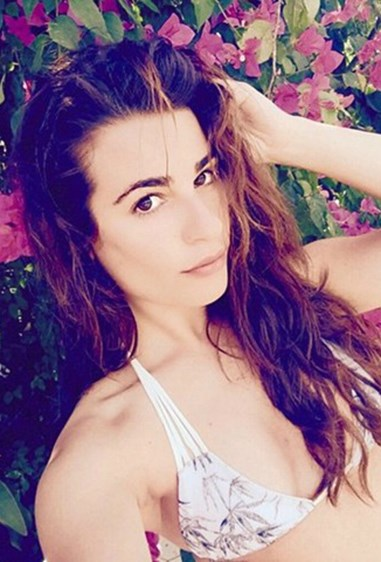 *Glee* star Lea Michele babes out in bareface and a bikini.