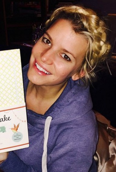 Jessica Simpson radiates a post-bub glow, adding to the cuteness with a youthful milkmaid braid.