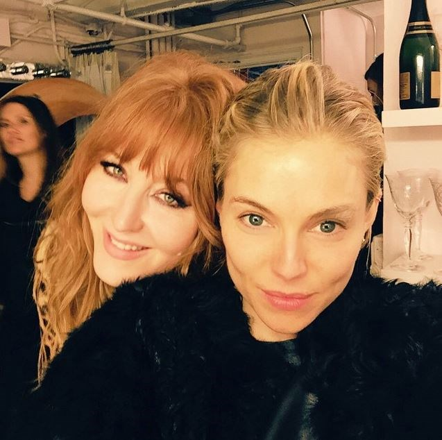 Sienna Miller poses with famous makeup artist, Charlotte Tilsbury. Which is ironic, seeing as she's not wearing a scrap of the stuff.