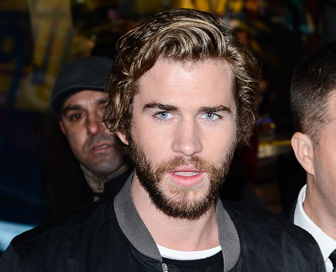 *Hunger Games* star Liam Hemsworth has a new hairstyle and it's changed his WHOLE (handsome) face.