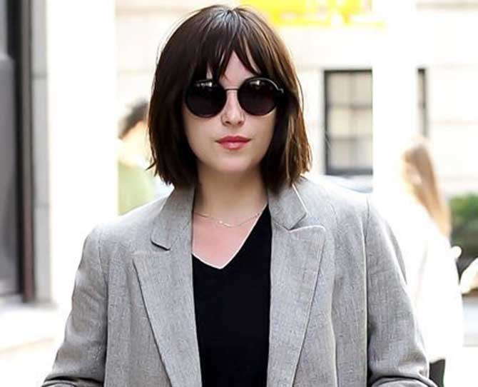 And we LOVE it! Dakota kept her bangs intact and opted for wispier ends which makes her look a little edgier.