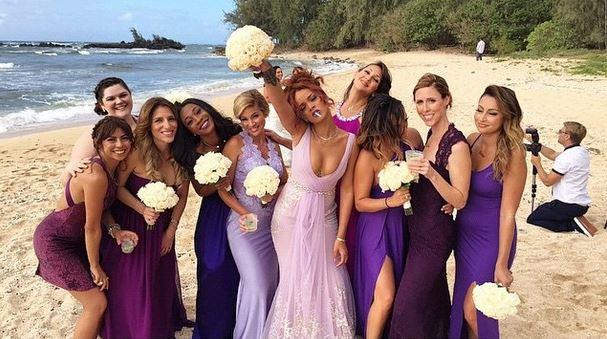 **Rihanna** <br><br> Rihanna managed to steal the show at pals Aaron and Jennifer's wedding wearing a lilac dress with a plunging neckline, completing the cool-girl look with a cigarette. After all, she is Bad Gal RiRi.