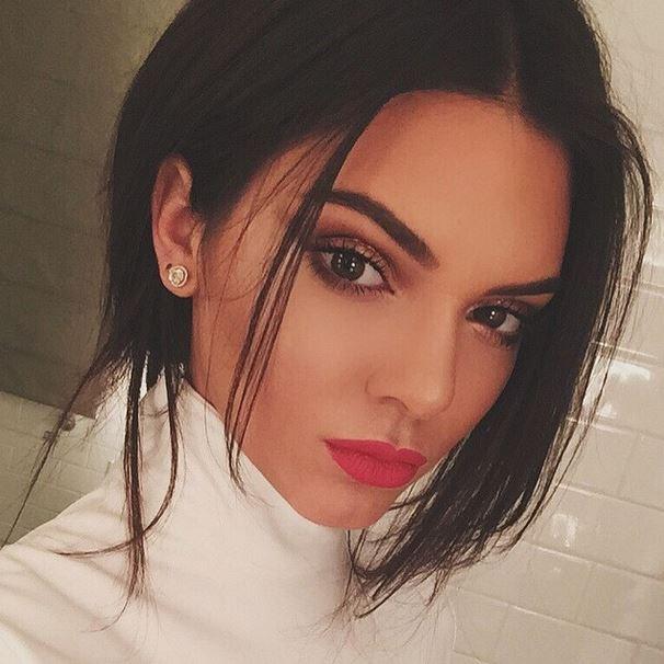It looks like Kendall Jenner has copied Kim Kardashian's Paris Fashion Week look by trading in her brunette locks to...