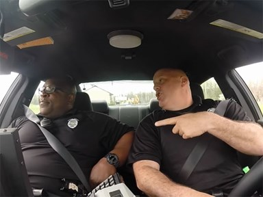 These cops singing all your favourite songs while on patrol are ALL OF US