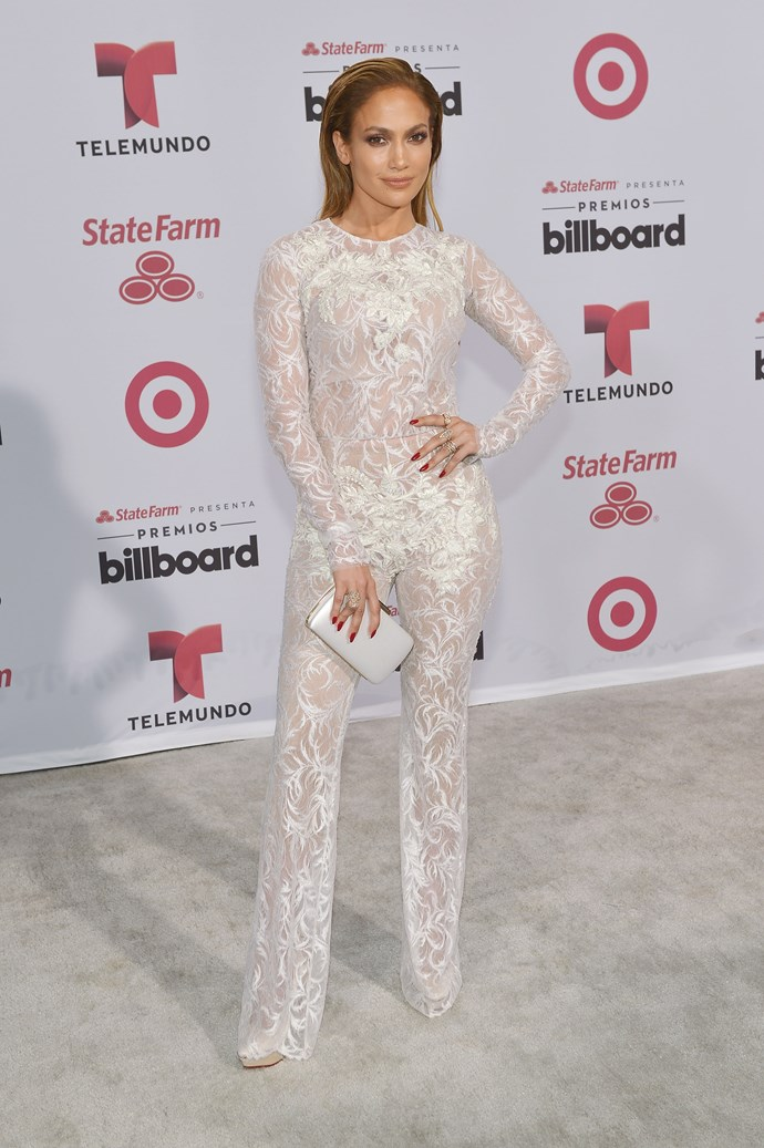 A white lace jumpsuit? Of course Jen went there. And in Zuhair Murad no less. Here she is BOSSING the Billboard Latin Music Awards red carpet.