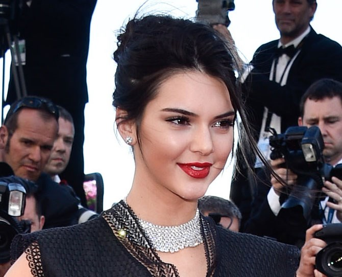 Kendall Jenner's lipstick game is SO DAMN STRONG. You can never go wrong with statement red and a touch of gloss.