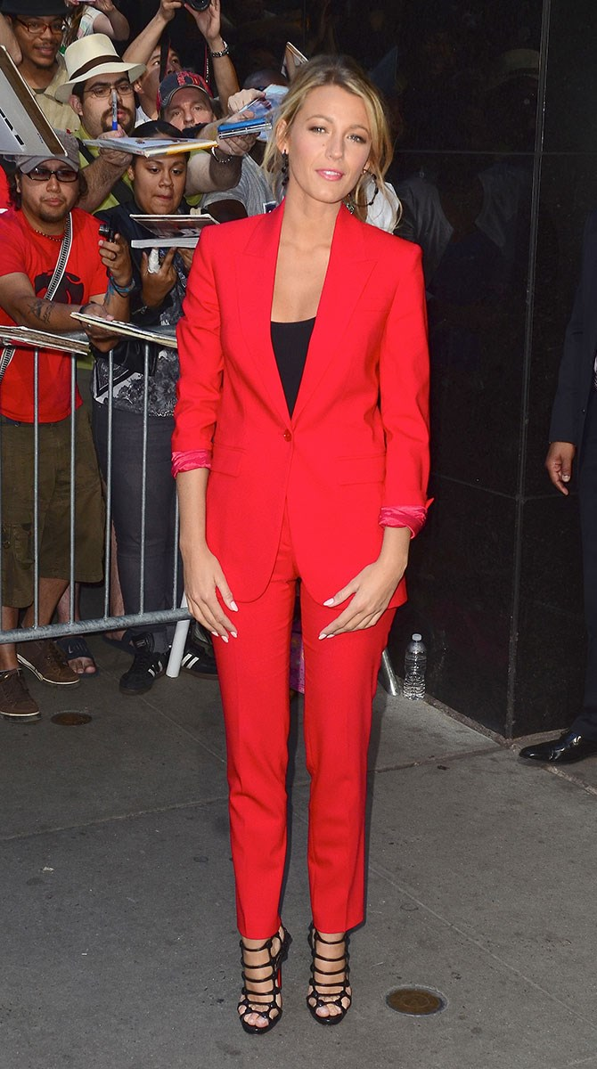 Part ringmaster, part power woman. This candy red suit is EVERYTHING.