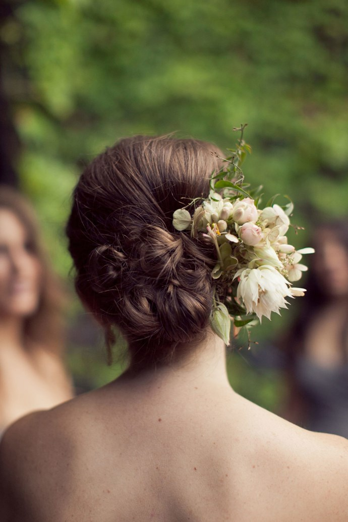 21. Bloom-Adorned Low Bun *(via Isabelle Selby Photography)*