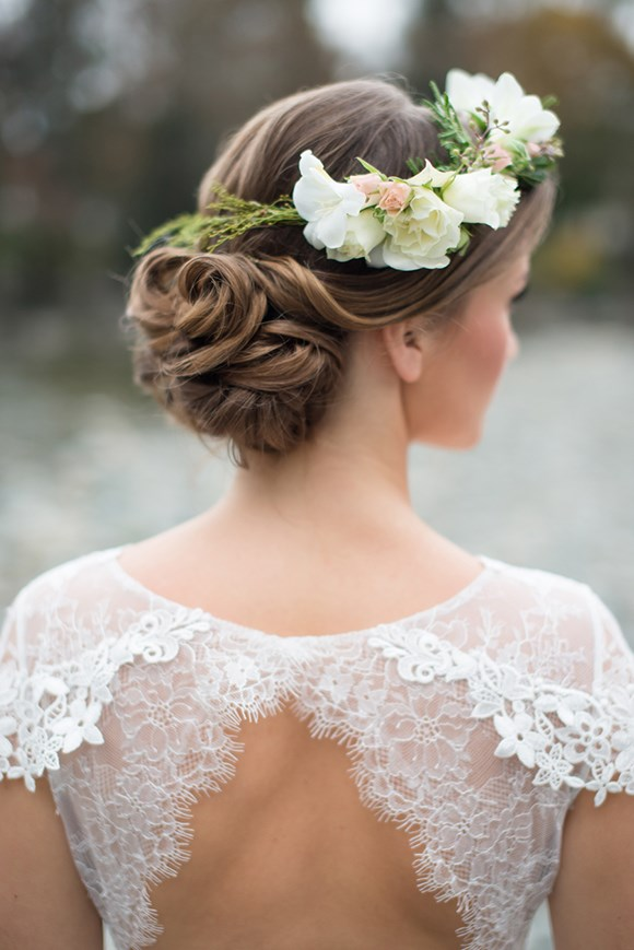 22. Sweet Chignon Complete With Pretty Petals *(via Christine Graham Photography)*