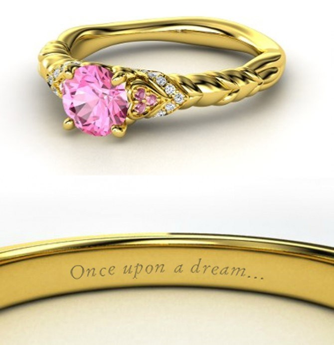 Princess Aurora's STUNNING ring is nothing to be yawned at with a pretty pink sapphire set into golden twists – perhaps a homage to her lush hair?