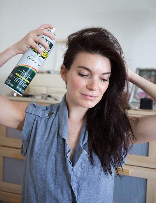 **3. Spray starch can double as dry shampoo.** A lot of dry shampoos contain starch, so if you run out of your favourite formula, use a can of starch from your laundry to get the same effect. Hold the can six to eight inches away and spray the oilier areas to make your hair look fresh again.