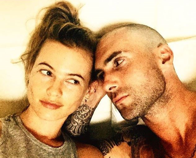 """Adam shared this snap of his new badass (lack of) hair with the caption, """"She's into me…I think…"""". Yeah, we think Behati approves of the big shave too."""
