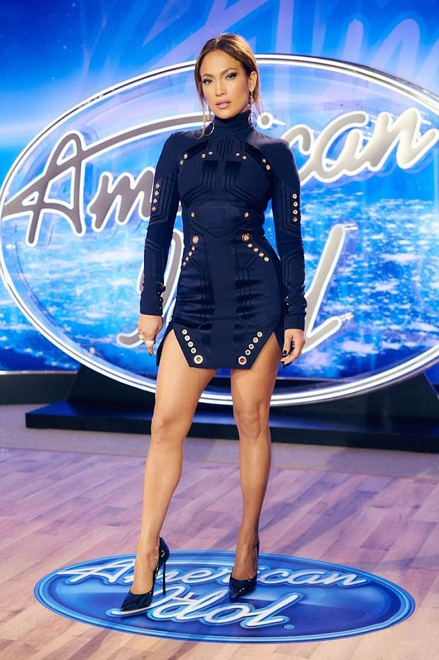 LEGS. FOR. DAYS. Jen looks smoking in this Thierry Mugler mini on the set of the final season of American Idol.