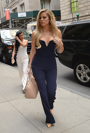 Khlo teamed this indigo jumpsuit with nude accessories for classic cool