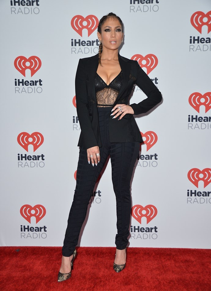 How to make a black pant suit sexy a la JLo: lace and boobs.