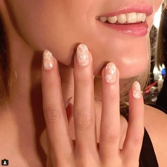 "**Dainty Designs:** 5. Pretty Pearls and Petals at Erin Fetherston Via [@misspopnails](https://instagram.com/misspopnails/|target=""_blank"")"