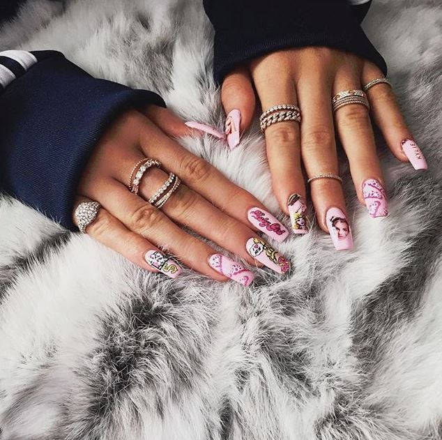 Kylie Jenner's nails are quickly becoming more Insta-worthy than those lips of hers, and given they induce serious manicure envy, we thought we'd look back at all the times she gave us #NailGoals. Because, she's single-handedly put stiletto nails on the map. 1. That time she got Barbie nails <3.
