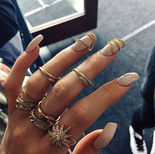 12. That time she adorned her talons with golden beads.