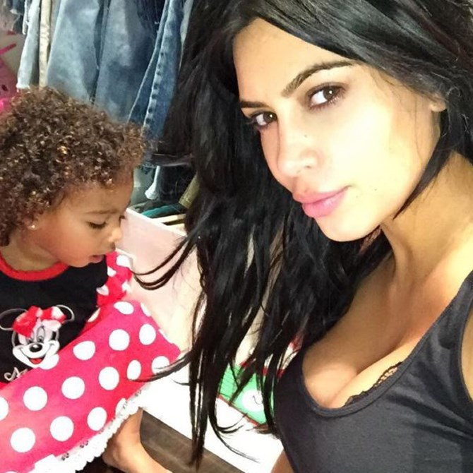 """Kim Kardashian shared this adorable pic of Nori on Instagram and would you just check out those curls? [And will our ovaries EVER stop exploding](http://www.cosmopolitan.com.au/celebrity/celebrity-gossip/2015/9/all-the-times-north-west-made-our-ovaries-explode/ target=""""_blank"""")?"""