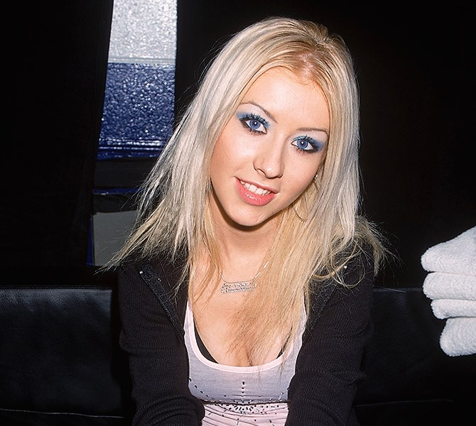 **4. Blue eye shadow THEN** Christina Aguilera was a huge fan back in the day. And although we've been scared to wear it ourselves ever since...** **