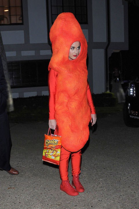 **A Cheeto**  Katy Perry literally had us lol'ing when she wore this Cheeto costume. Firstly because it's random AF. Secondly because the look on her face is how we actually imagine a Cheeto to look if it were a human. So pathetic and ready for consumption!