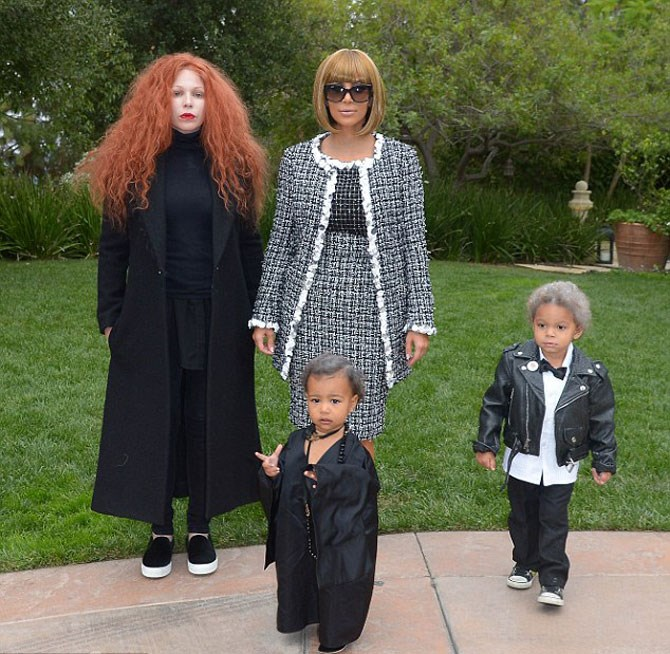 **The Vogue Squad**  Anna Wintour is many things, but sexy she is not. Kim Kardashian dressed up as the Vogue editor-in-chief in 2014 and we were all kinds of impressed. North played the role of editor Andre Talley while makeup artist, Joyce Bonelli, complete the squad by playing creative director, Grace Coddington.