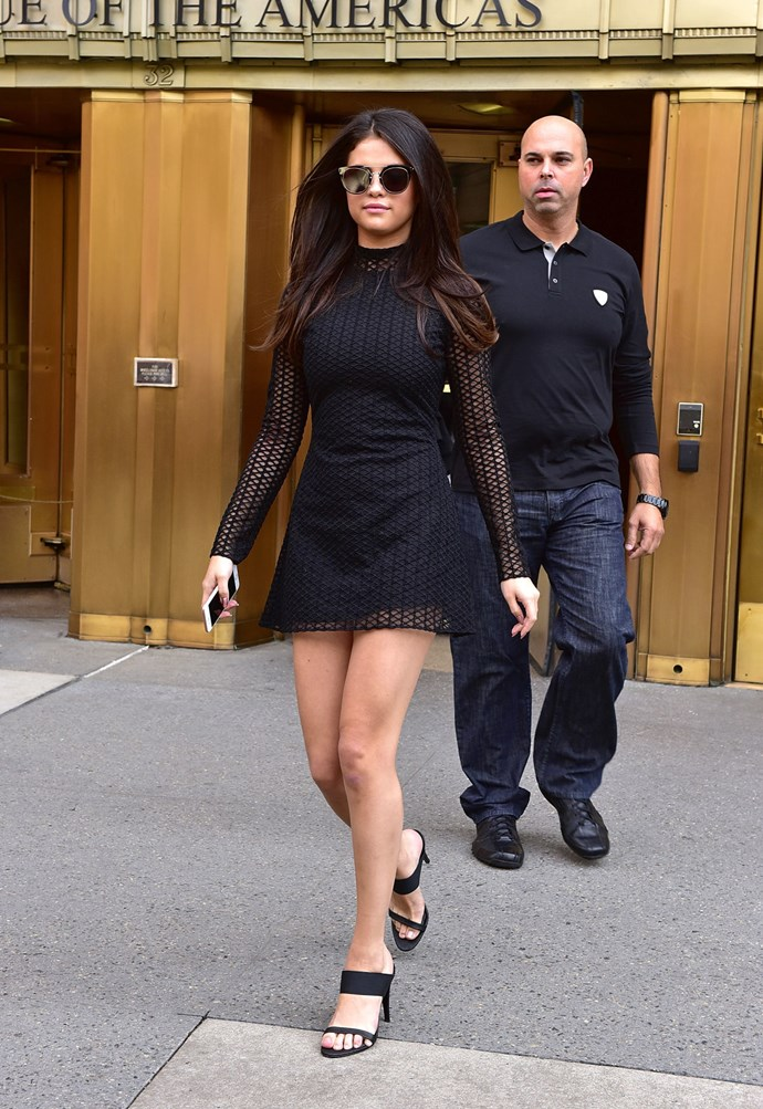Selena has been slaying in the fashion stakes lately, catching our attention every time she is seen stepping out. But last week we weren't just impressed by how her outfits looked, but rather, how many of them there were in such a short amount of time! Starting with this mesh LBD, mirrored lens sunglasses and black mules.