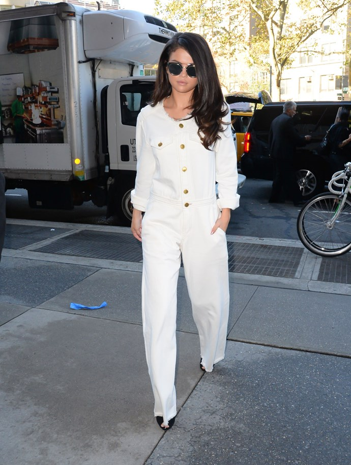 Not long after she was seen in this all-white jumpsuit by Isabel Marant for a radio interview, paired back with statement sunnies, black heels and a blowdry to end all blowdrys.