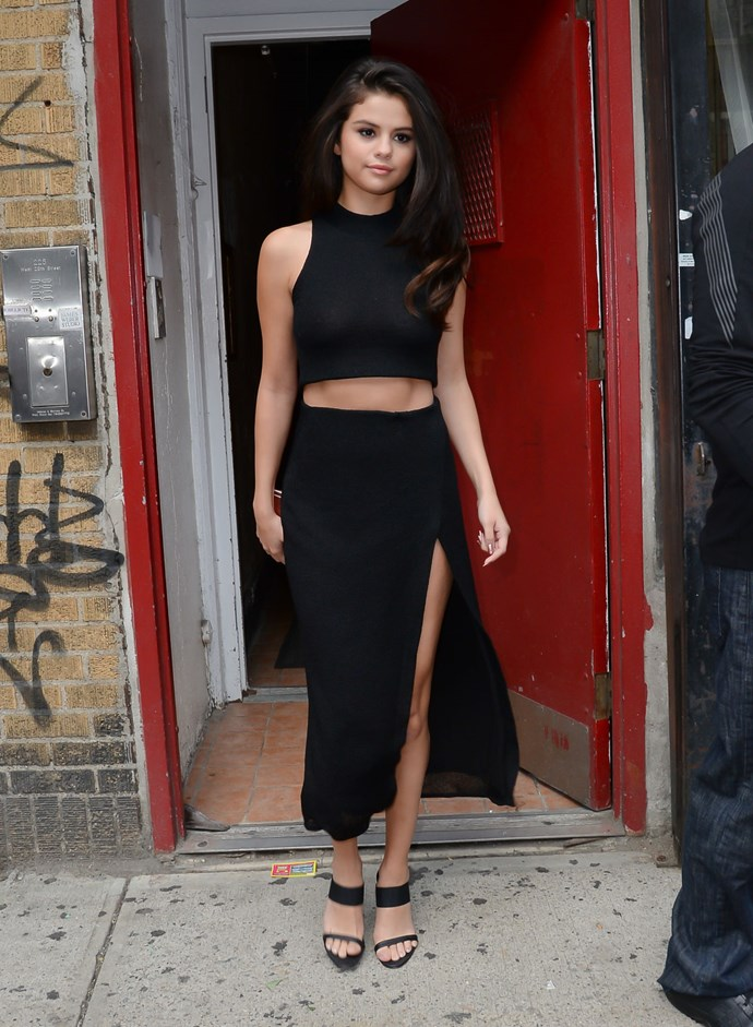 Then it was all about the abs (no, seriously, look at those abs) in this plain black crop top and midi skirt combo. Of course, with a thigh high split for good measure.