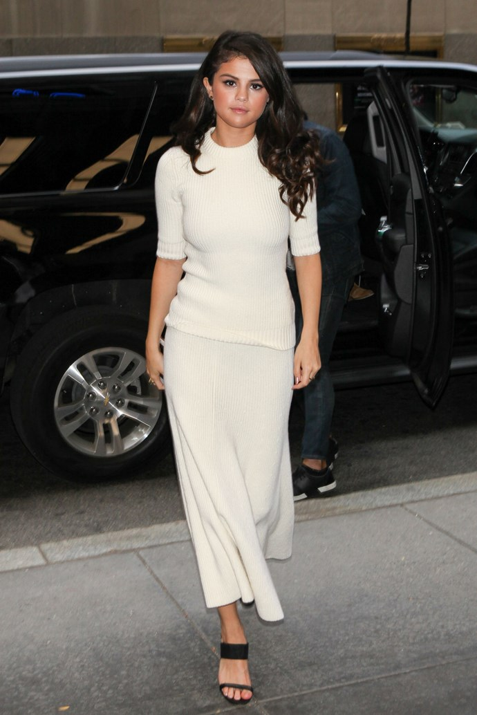 The next day Selena showed up to *The Tonight Show* wearing a white ribbed knit top and midi skirt combo. This look kind of makes us want to delay summer just a little bit longer. We know, shock, horror.