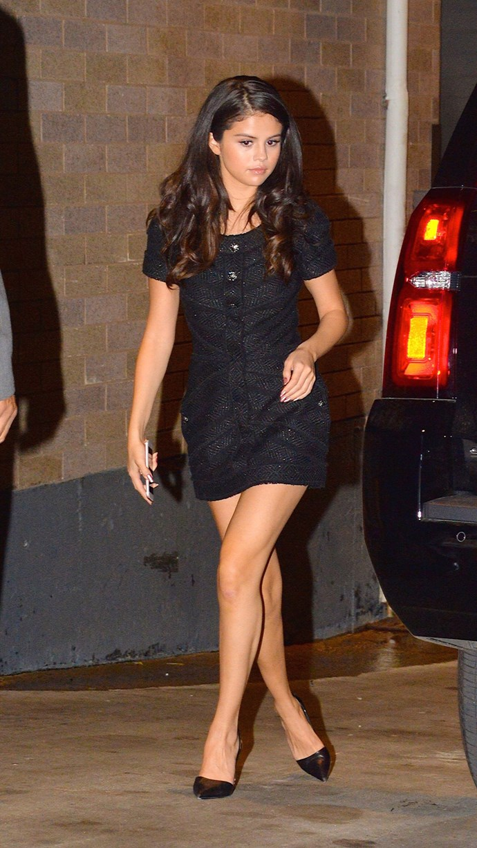 Later that night she left NBC studio rocking another mini LBD, this time made of sparkly tweed with a cute button down front. Those black pointy pumps elongate her legs like nothing else!