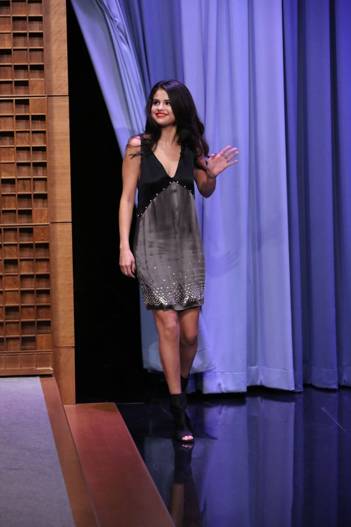 In front of the cameras on *The Tonight Show* Selema wore a silk shift dress in grey and black, embellished with sparkles. A red lip and peep toe booties were the perfect accompaniments.