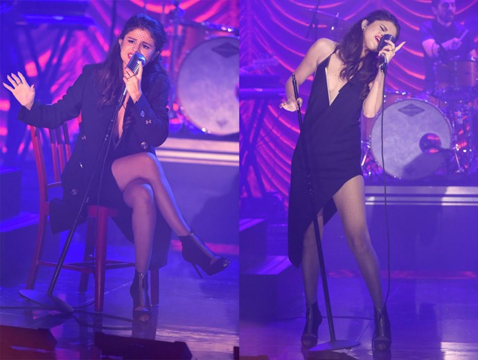 For her performance it was all kinds of Broadway feels with this low-cut, asymmetrical dress and netted veil over her eyes.