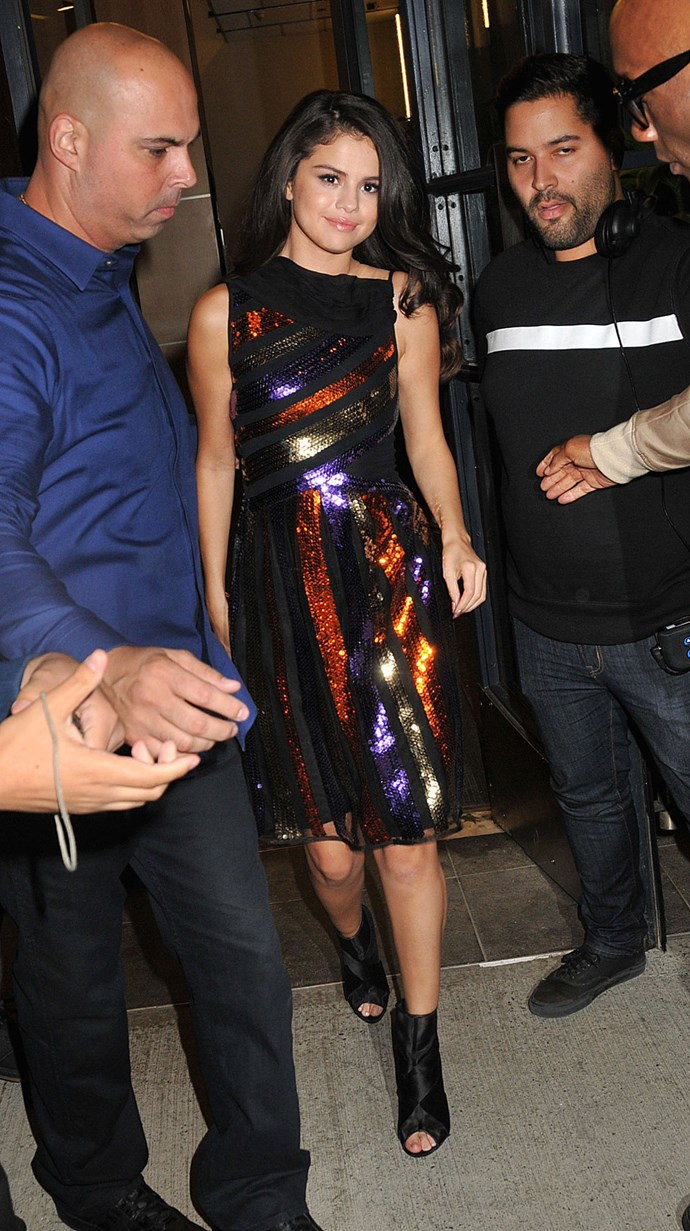 And last but certainly not least, she stepped out in this rainbow sequinned, knee-length dress complete with black satin peep toe booties. If that wasn't a fashion marathon of sorts, we don't know what is!
