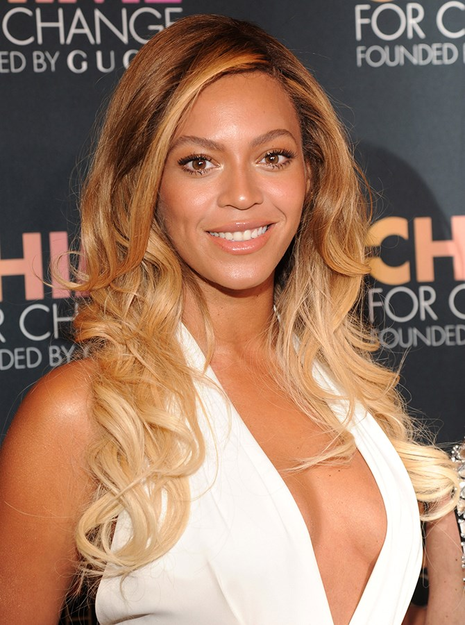 3. Golden skin like Beyoncé's is complemented beautifully with a peachy, caramel-toned glossy take on nude.