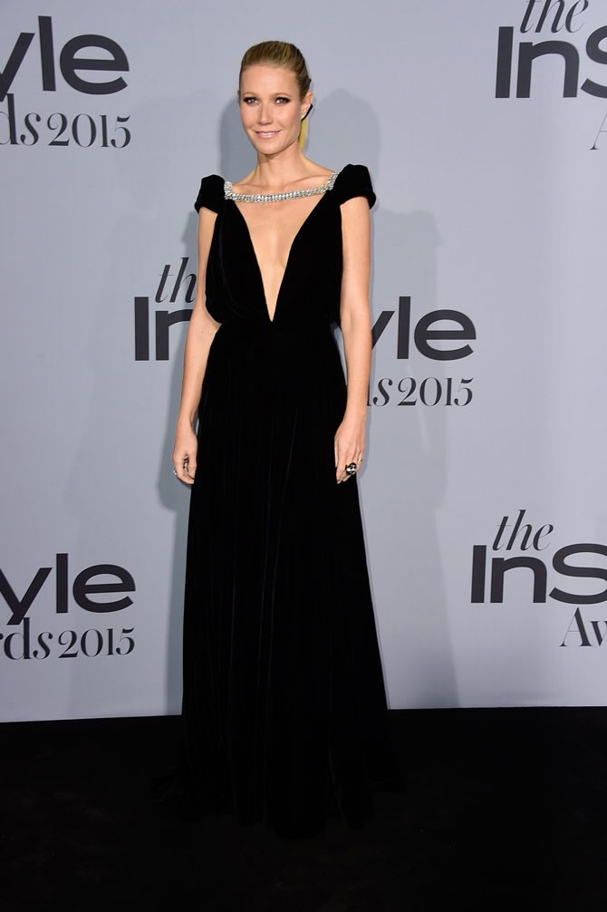 Gwynyth Paltro looked SO elegant in this floor length black gown with low-cut neckline.