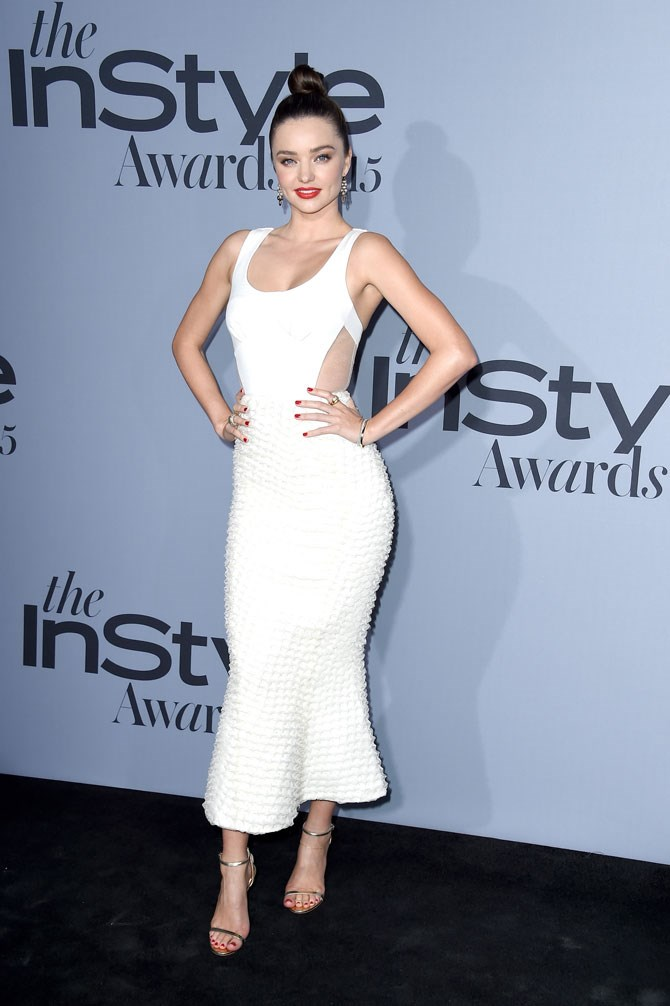 Miranda Kerr opted for all white in this figure hugging dress. The slick hair and red lip added a little bit of glam to the look.