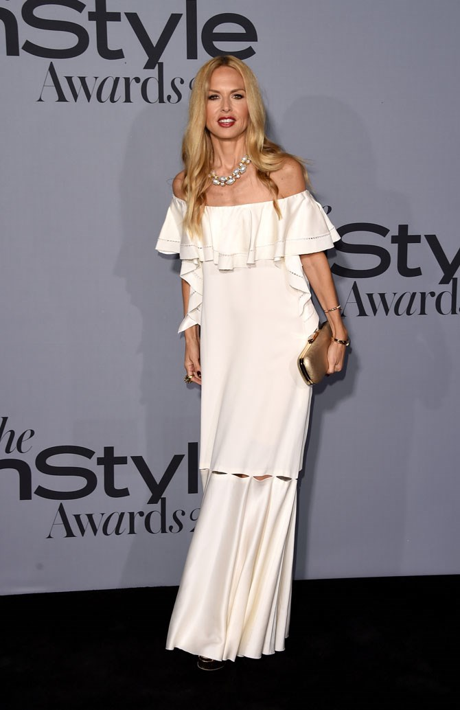 Celebrity stylist, Rachel Zoe, also opted for all-white, but kept things true to her usual boho style with this off-the-shoulder dress.